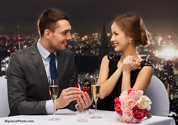 restaurant, couple and holiday concept - smiling man proposing t
