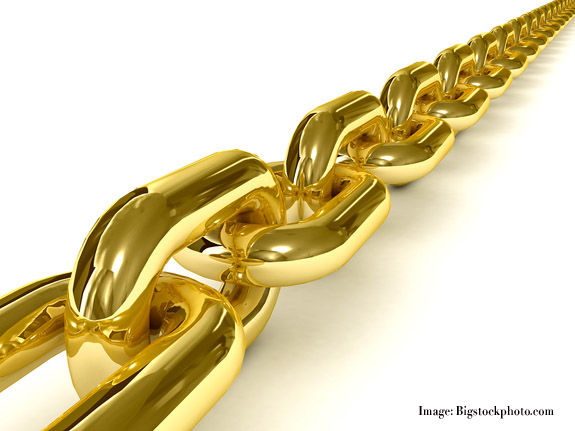 Golden chain over white background. 3D Concept illustration.