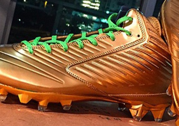 1c85ab0c8 The Nike Vapor Speed Mid TD shoes were gilded in 24-karat gold flake paint  and accented with a gold-plated sole and cleats. Lime green laces — to  complement ...