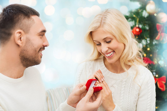 love, christmas, couple, proposal and people concept - happy man